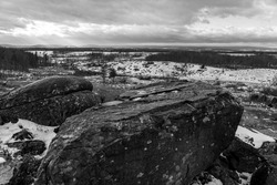 A black and white photo of the view from Little Round Top on the Gettysburg National Military Park in Pennsylvania where union and confederate soldiers battled in July of 1863.