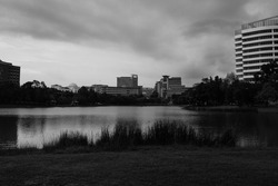 A black and white picture with noise effect of sunset in Putrajaya lake environment with building insight.