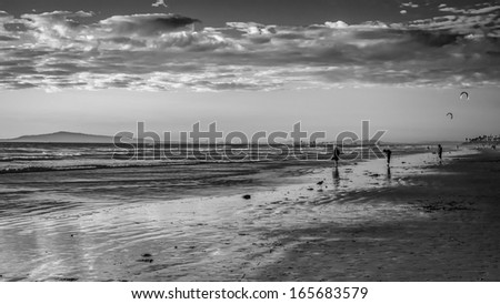 A black and white shot from Huntington Beach looking down to Long Beach during a cold winter sunset.