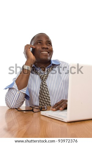 A black businessman working at his desk on a laptop