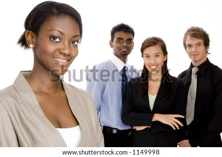 A black businesswoman (in focus) stands in front of the rest of her business team (off focus)