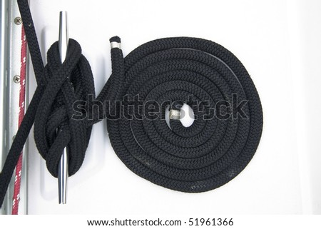 A black coiled rope onboard a small vessel