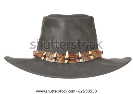 A black cowboy hat with crocodale teeth in front on white background.