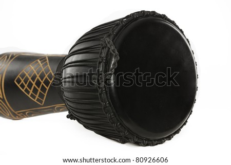 A black djembe conga drum isolated against a white background. - stock photo