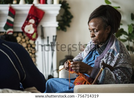 A black elderly woman in Chrismas holiday