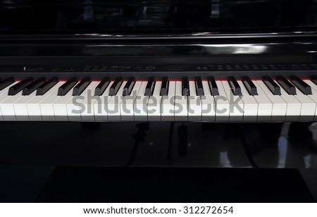 A black electronic piano with piano keys