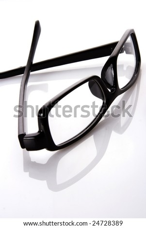 A black frame eyeglasses in plain white background with reflection.