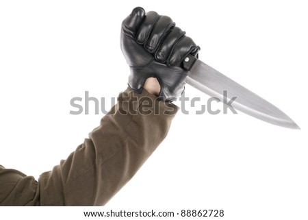 a black gloved hand holding a knife
