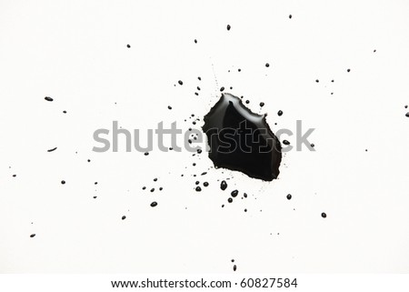 a black ink drops on white