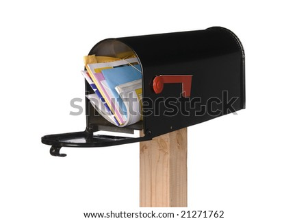 A black isolated mailbox filled with letters, bills, greeting cards and a magazine. - stock photo