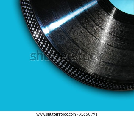 A black, isolated record is spinning a song on a blue background.