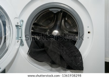 A black lace dress just washed in an automatic washing machine, delicate wash mode  #1361938298