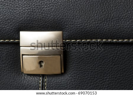 A black leather bag - the buckle - detail - stock photo