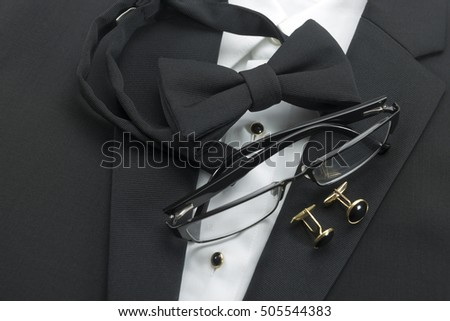 A black pre-tied bow tie with matching cuff links  #505544383