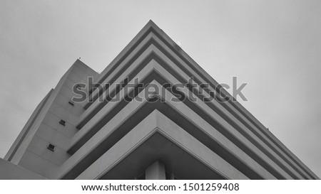 A black white picture of building in unique shape, corner shape of building in black-white. Black-white Architectural picture.  #1501259408