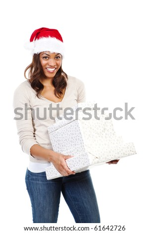 A black woman celebrating christmas carrying gift boxes
