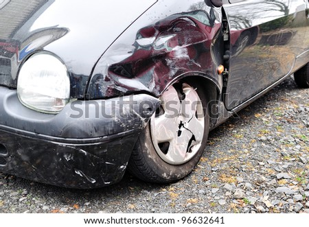 A black wrecked car