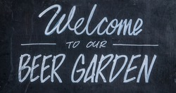 A Blackboard Sign Outside A Bar Or Pub Saying Welcome To Our Beer Garden