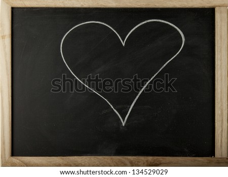 A blackboard with a hand drawn heart #134529029