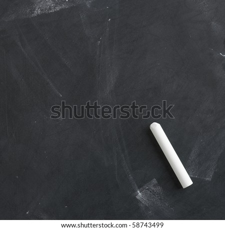 a blank blackboard, chalkboard and chalk straight on