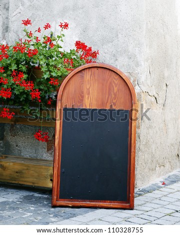 A blank blackboard in the street