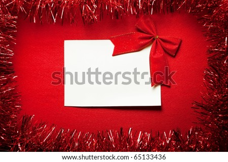 A blank card on a red background with decoration. For Christmas season messages or announcements.