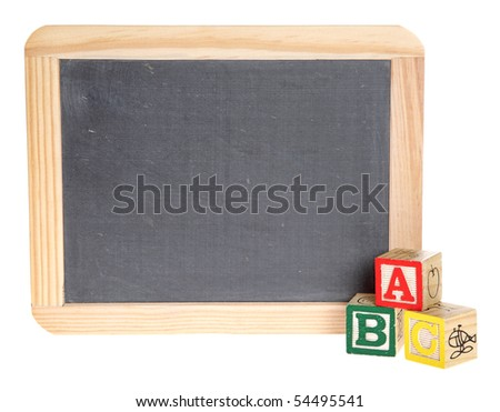 A blank chalkboard with ABC blocks in front of it.