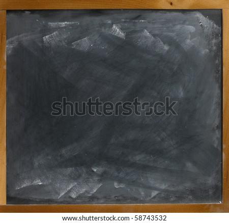 a blank empty frame blackboard, chalkboard  straight on - stock photo