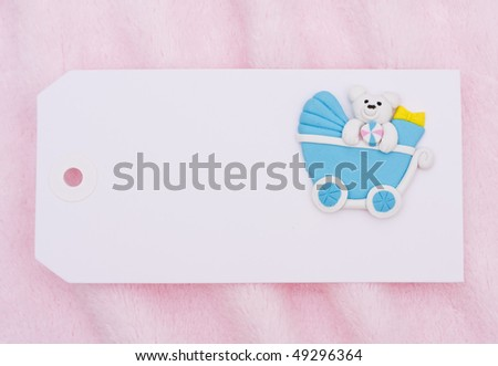 A blank gift tag with a baby stroller on a pink background, baby shower gift