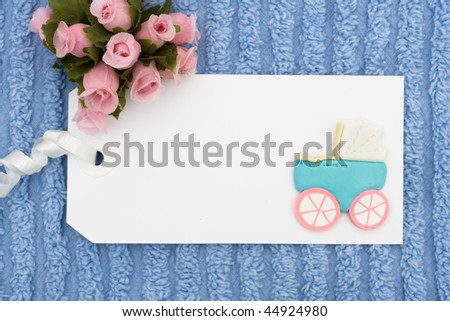 A blank gift tag with a blue background, baby gift