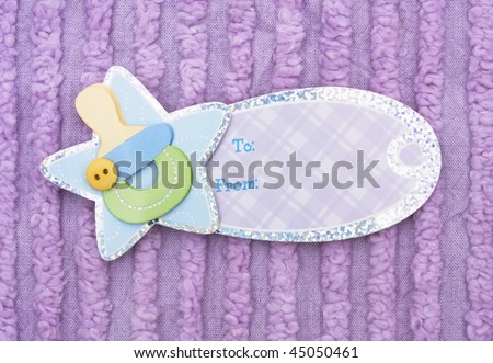 A blank gift tag with a purple background, baby gift
