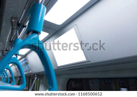 A blank lighted signboard inside a high speed train, with space for text. #1168500652