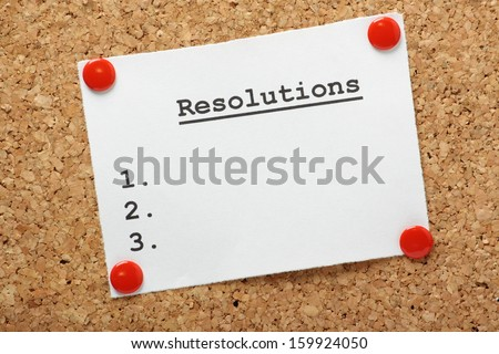 A blank list of resolutions for new year or in general pinned to a cork notice board with room for your text