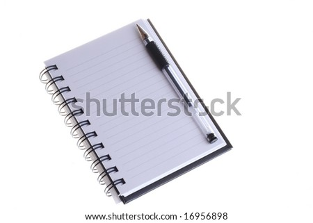 A blank notebook with a pen on top