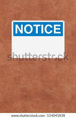 A blank notice sign mounted on a wall
