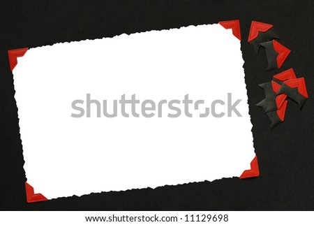 A blank photo on an album page. File has clipping path around photo and corners attached to photo.