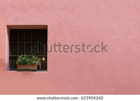 a blank pink pastel wall of a...