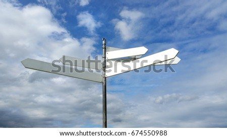 A blank signpost with multiple pointers against a blue summer sky with fluffy clouds #674550988