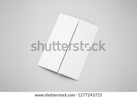 A4 Blank trifold Paper Brochure Mock up on soft gray background with shadow and highlight.3D rendering.