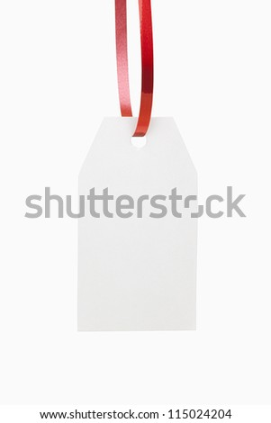 A blank, white christmas gift tag, includes clipping path