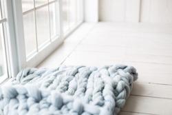 a blanket of Merino wool. grey blanket on wooden white background