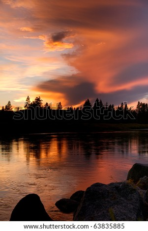 A blast of color after sunset along the Snake River in Wyoming - stock photo