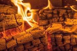 A blazing fire in the dark. Inflammation of firewood in the fire. A bright burning flames. Sparks and flames in the darkness. Red-hot heat and tongue flames.Fiery flaming bonfire.