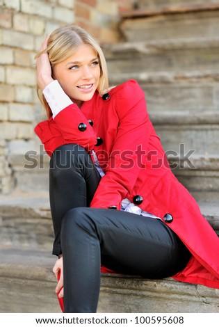 A blond beautiful woman outdoors