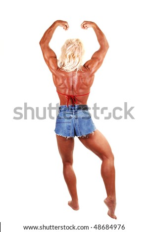 A blond muscular bodybuilding girl standing in the studio shooing her strong body from the back, over white background.