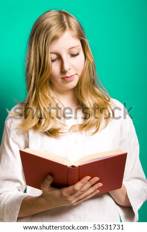 a blond teenager girl in white shirt reading a book