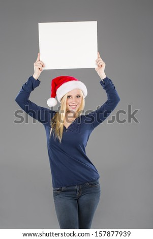 A blonde holiday model holding a blank sign