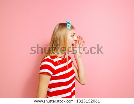 A blonde who screams someone on a pink background #1325152061