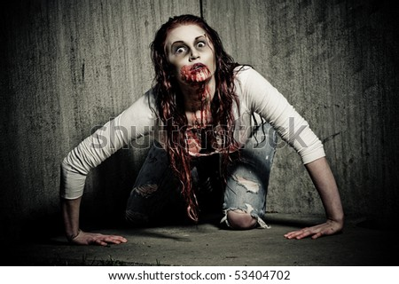 a bloody and scary looking zombie girl
