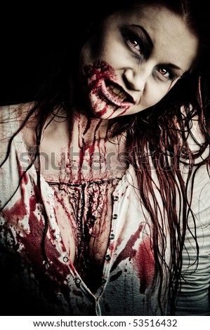 A Bloody And Scary Looking Zombie Girl Stock Photo ...